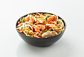 A bowl with shrimps, chicken, soya sprouts and vegetables