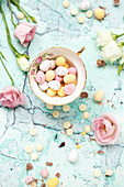 Pastel coloured mini eggs in a vintage tea cup