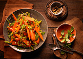 Carrot salad with orange, cinnamon and pine nuts