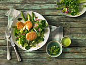Spring salad with a green vinaigrette and baked mozzarella