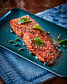 Sesame seed and soya salmon with beetroot leaves