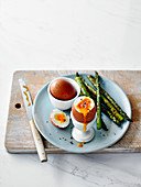 Boiled eggs with spiced asparagus soldiers