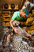 Taxidermist with leopard