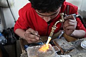 Goldsmith using blow torch