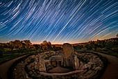 Sun and star trails over Dolmen de Lacara, Spain