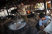Making palm wine, Myanmar