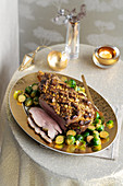 Saffron and nut leg of lamb with Brussels sprouts, sliced