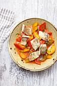 Carp on a pepper and potato goulash