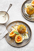 Wachau apricot dumpling in spiced crumbs with poppyseed cream