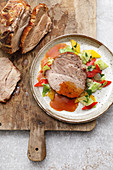 Austrian roast must pork with a pepper and white cabbage salad