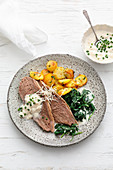 Prime boiled beef with creamy spinach and bread-roll horseradish