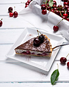 Vegan poppyseed and quark cake with sweet cherries and dark chocolate