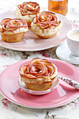 Puff pastry muffins with a flower-shaped apple
