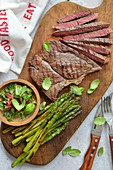 Grilled beef steak with grilled asparagus