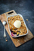 Vegan crumble with peaches, blueberries and oat flakes