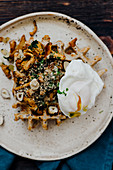 Waffles with poached egg and chanterelles
