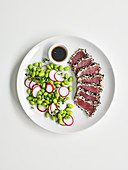 Tuna tataki with edamame and radish salad