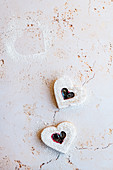Heart shaped cookies with raspberry jam
