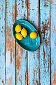 Lemons on a blued plate