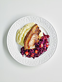 Pork chop with braised red cabbage and mashed potatoes