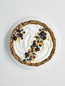 Granola breakfast tart with berries