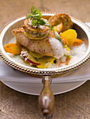 Fried wels catfish with plums and carrots