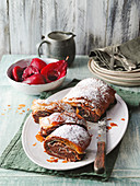 Chocolate strudel with red wine pears