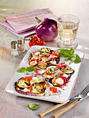 Grilled aubergine pizzas with courgette, salami and ham
