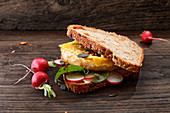A sandwich with celeriac, radishes and cheese
