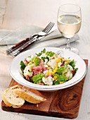 Cauliflower salad with hard-boiled eggs and ham