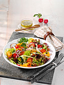 Colourful vegetable salad with a honey and mustard dressing