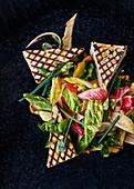 Grilled tofu on a vegetable salad