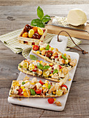 Colourful chicken baguettes with scamorza and cherry tomatoes