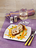 Turkey roulade with a herb crust on a carrot medley