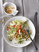 Chinese cabbage salad with olives, beansprouts and almonds