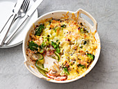 Vegetable gratin with mushrooms and broccoli
