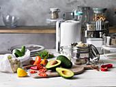 An arrangement of chopped vegetables and kitchen utensils