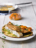 Rose fish omelette with a carrot medley