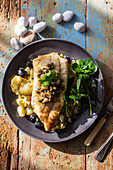 Cod fillet with potatoes, olives and capers
