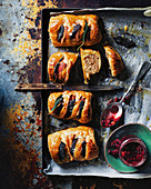 Bacon and pork sausage rolls, beetroot sriracha ketchup