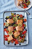 Baked salmon on summer vegetable