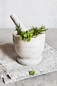 Green herbs in mortar
