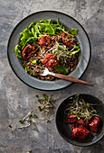 Black rice with arugula and sun-dried tomatoes