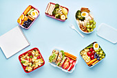 School lunchboxes with various healthy nutritious meals