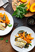Pumpkin strips with pesto and cheese