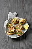Sardine and aubergine skewers on baguette