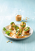Mini chicken wraps with spinach and yellow pepper
