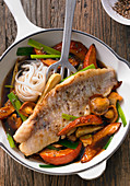 Rose fish fillet on a colourful Hokkaido pumpkin and vegetable medley in a beer teriyaki sauce