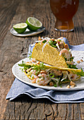 Mussels and shrimp salad with a beer vinaigrette served in a taco shell