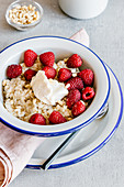Oatmeal with mascarpone cheese, raspberry, pine nuts and honey